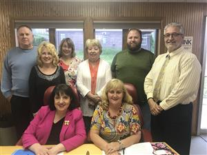 Picture of the Superintendent with 7 Board Members